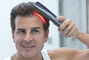 Laser comb hair regowth treatment